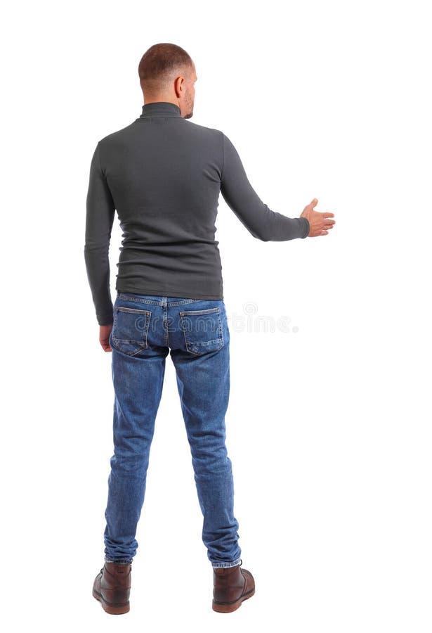 Opinião de verso o homem no aperto de mão da camisa imagem de stock