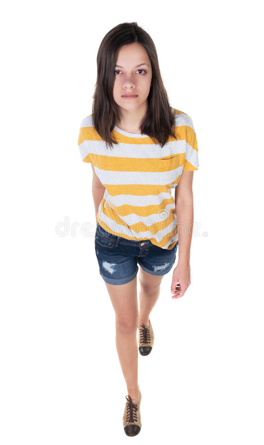 Opinião dianteira a mulher de passeio nas calças de brim fotografia de stock royalty free