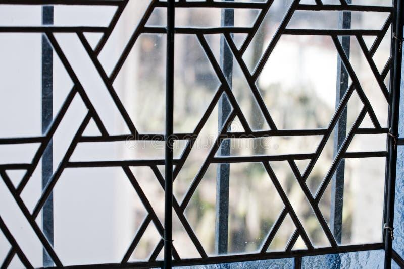 Opinião do detalhe do teste padrão do close up da janela de vidro colorido imagem de stock