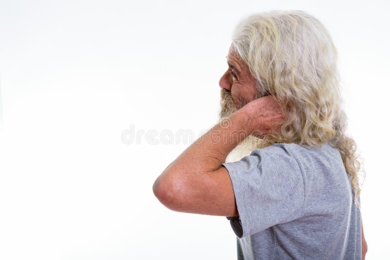 Opinião do perfil o homem farpado superior forçado que tem a dor no n fotos de stock