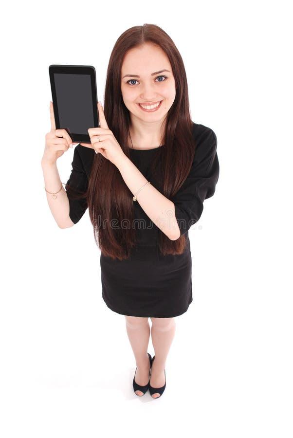 Opinião feliz do adolescente do estudante de cima de e mostrar uma tabuleta imagem de stock