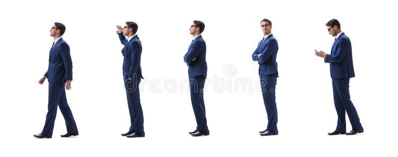 Opinião lateral ereta de passeio do homem de negócios isolada no backgro branco foto de stock