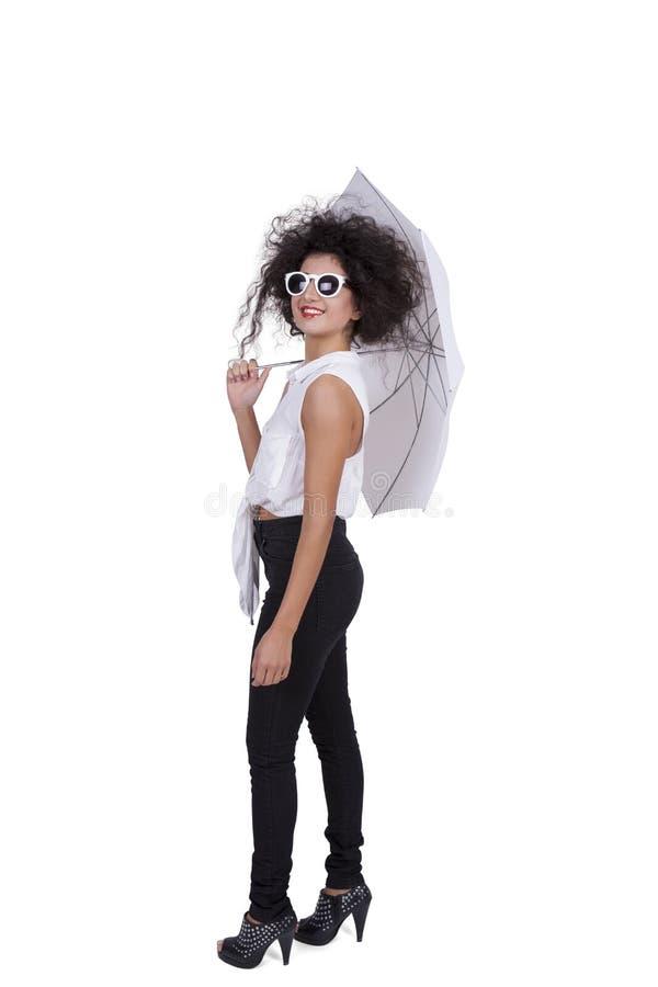 Opinião lateral a fêmea nova com guarda-chuva imagens de stock royalty free