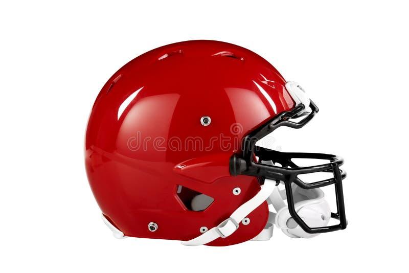 Opinião lateral vermelha de capacete de futebol fotografia de stock