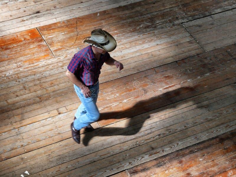 Opinião ocidental tradicional do dançarino da música folk do único homem de cima do efeito do dinamismo do borrão imagem de stock