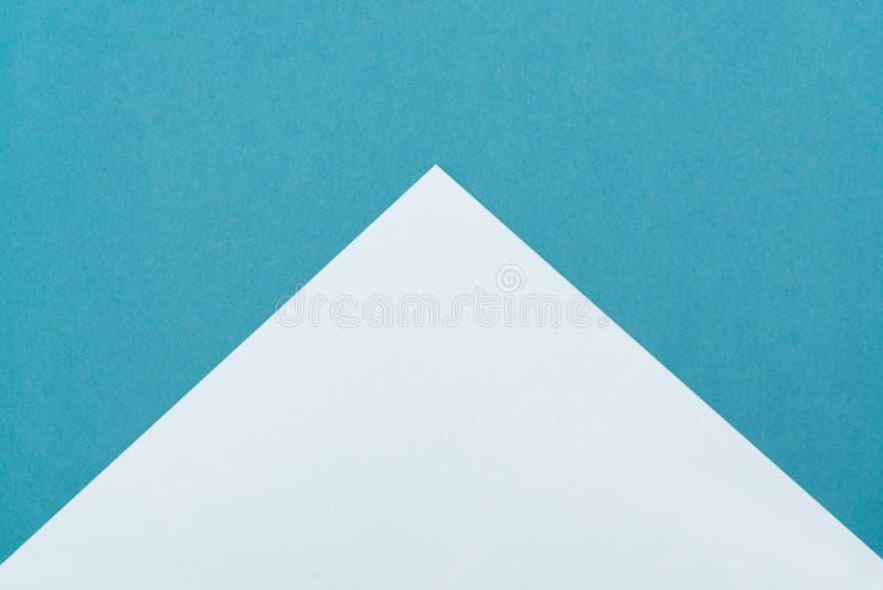 Opinião superior colocada plano pastel elegante de papel colorido, cor verde do fundo imagem de stock
