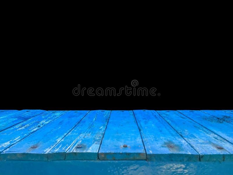 Opinião superior do assoalho de madeira azul com fundo preto foto de stock