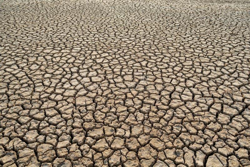 Opinião superior do teste padrão da textura do aquecimento global da argila da sujeira do calor do deserto imagem de stock royalty free