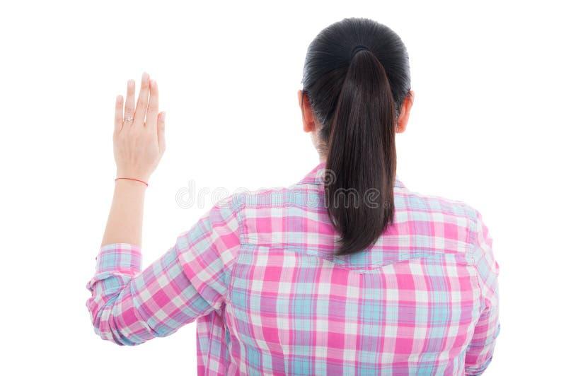 Opinião traseira a fêmea que faz uma promessa imagem de stock royalty free
