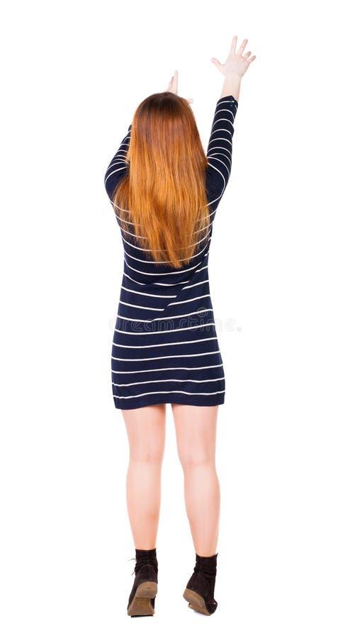 Opinião traseira a mulher apontando fotografia de stock