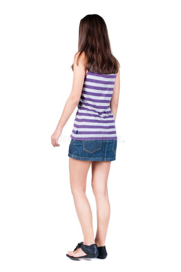 Opinião traseira a mulher de passeio imagens de stock
