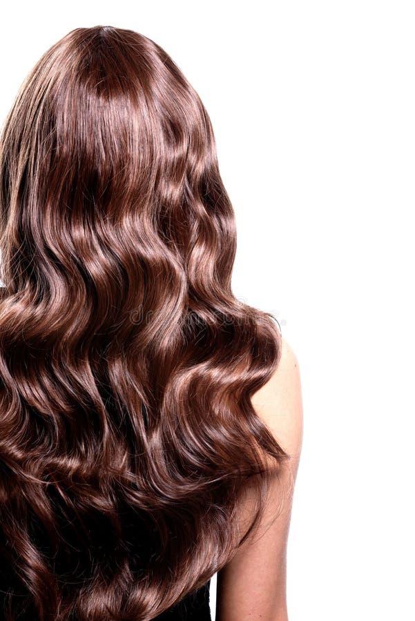 Opinião traseira a mulher moreno com cabelo encaracolado preto longo fotografia de stock