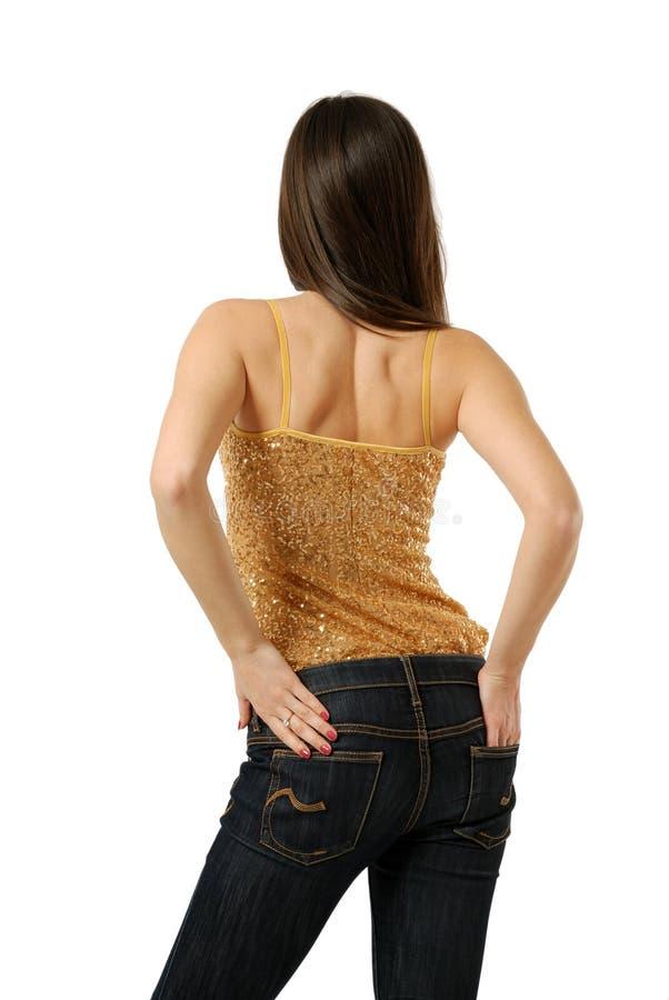 Opinião traseira a mulher nas calças de brim isoladas no branco fotografia de stock