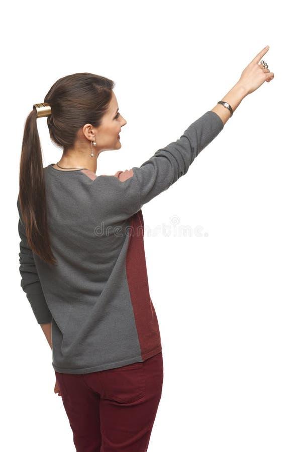 Opinião traseira a mulher que aponta no espaço da cópia fotografia de stock royalty free