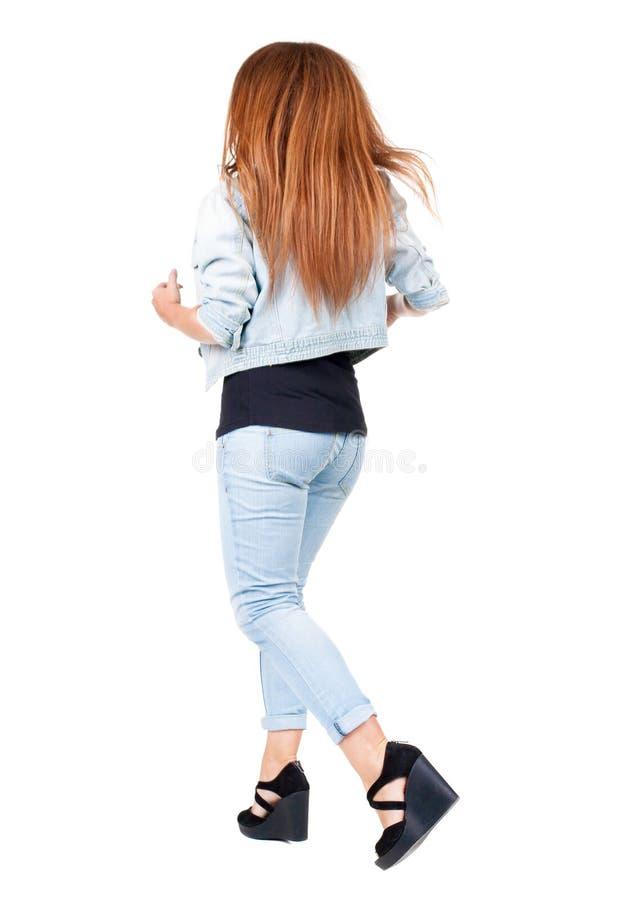 Opinião traseira mulher running com cabelo do voo foto de stock