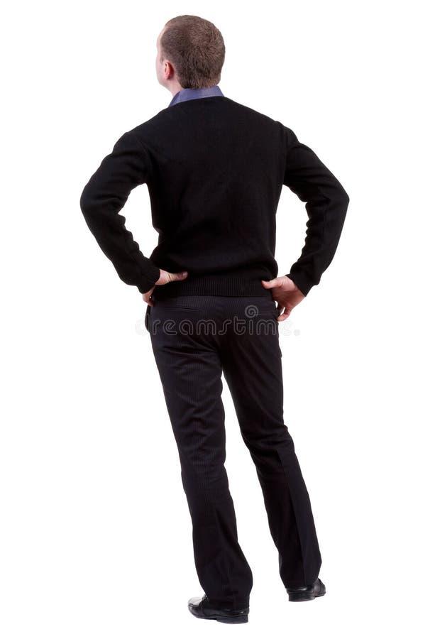 A opinião traseira o homem de negócio anticipa foto de stock