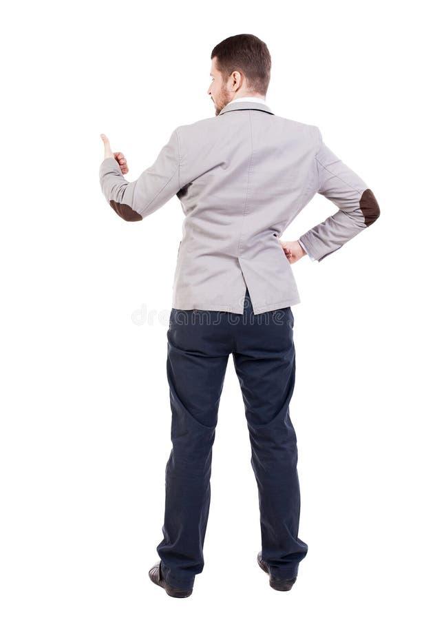 A opinião traseira o homem de negócio mostra os polegares acima foto de stock
