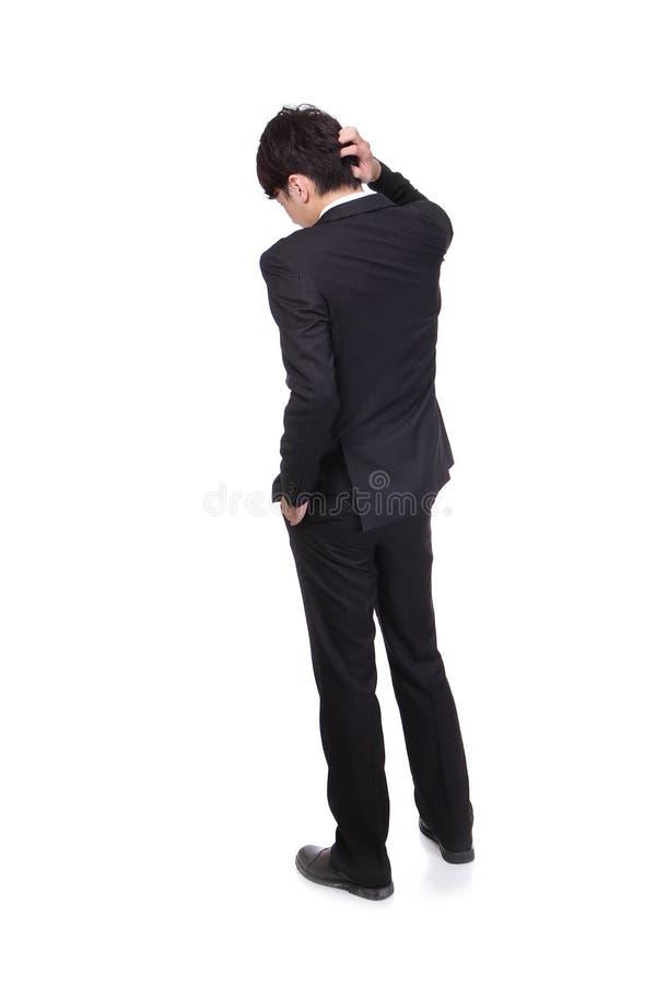 Opinião traseira o homem de negócio novo confundido fotografia de stock royalty free