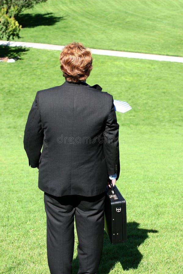 Opinião traseira o homem de negócios em olá! fotografia de stock