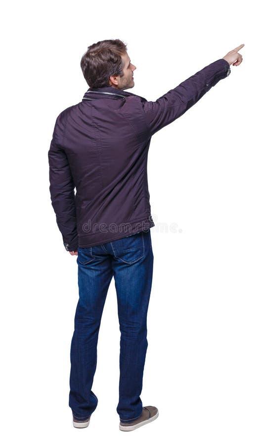 Opinião traseira o homem em pontos do Parka sua mão fotos de stock royalty free