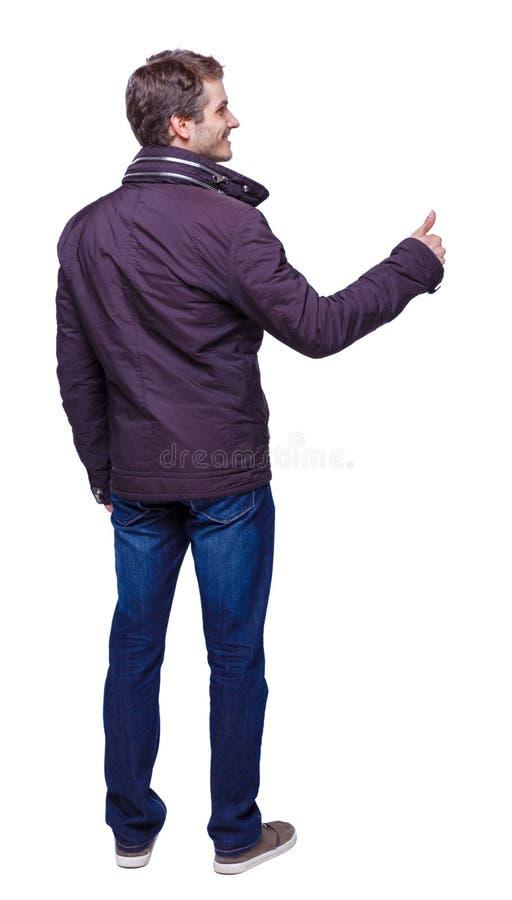Opinião traseira o homem nos polegares do Parka acima fotos de stock royalty free