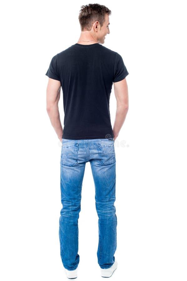 Opinião traseira o homem ocasional novo fotografia de stock