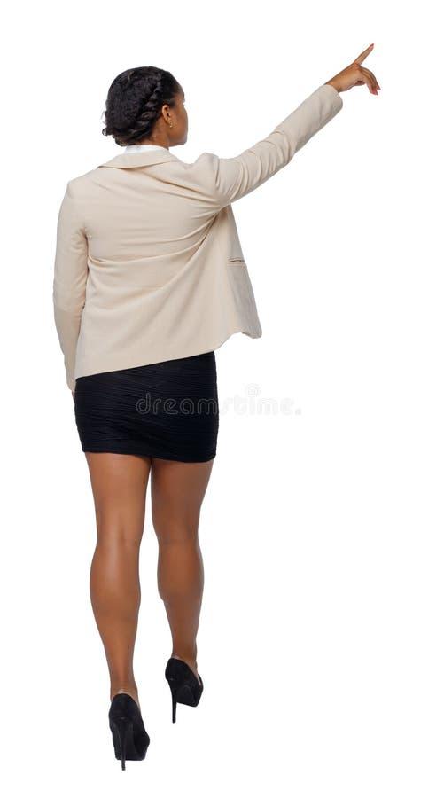Opinião traseira um afro-americano preto em um terno que vá e aponte com sua mão foto de stock royalty free