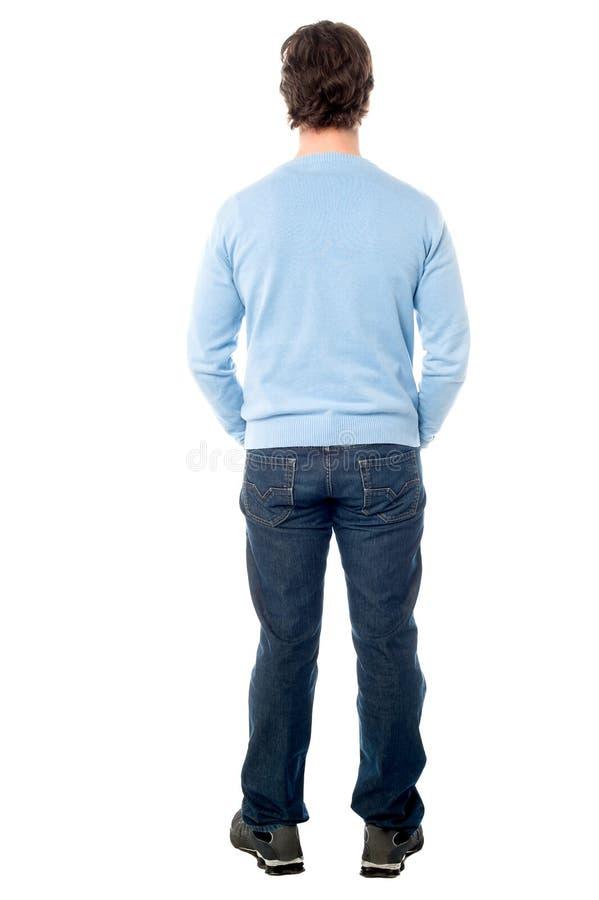 Opinião traseira um homem em ocasional foto de stock