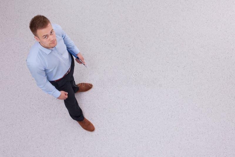 Opinión de arriba la gente que tiene reunión de negocios, foto de archivo