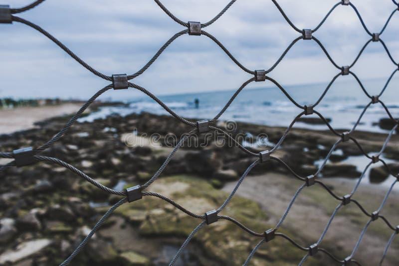 Opinión del mar con la rejilla imagen de archivo libre de regalías