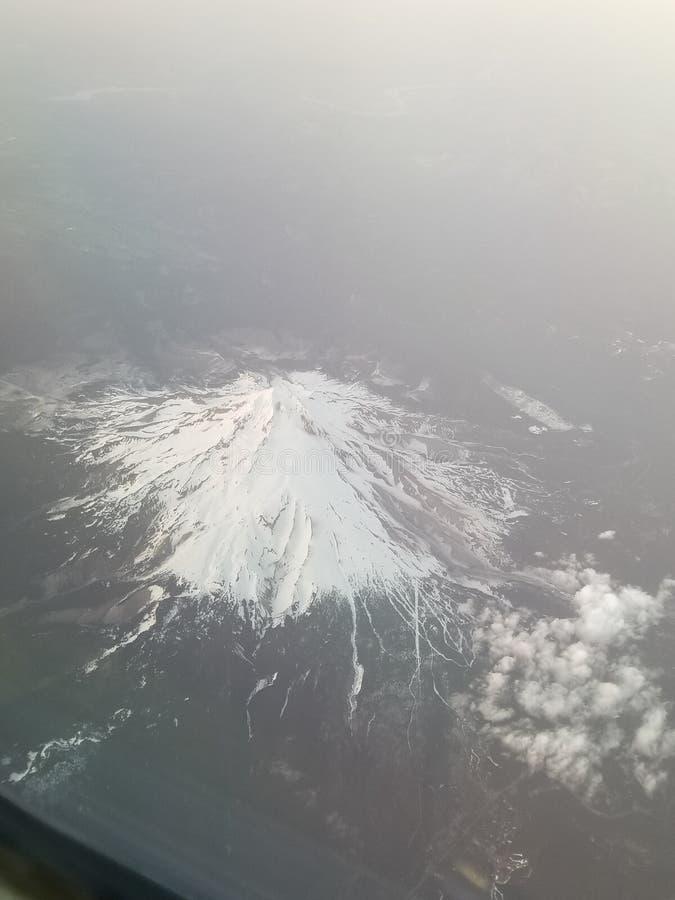 Opinión del Mt Rainer del aeroplano imagenes de archivo