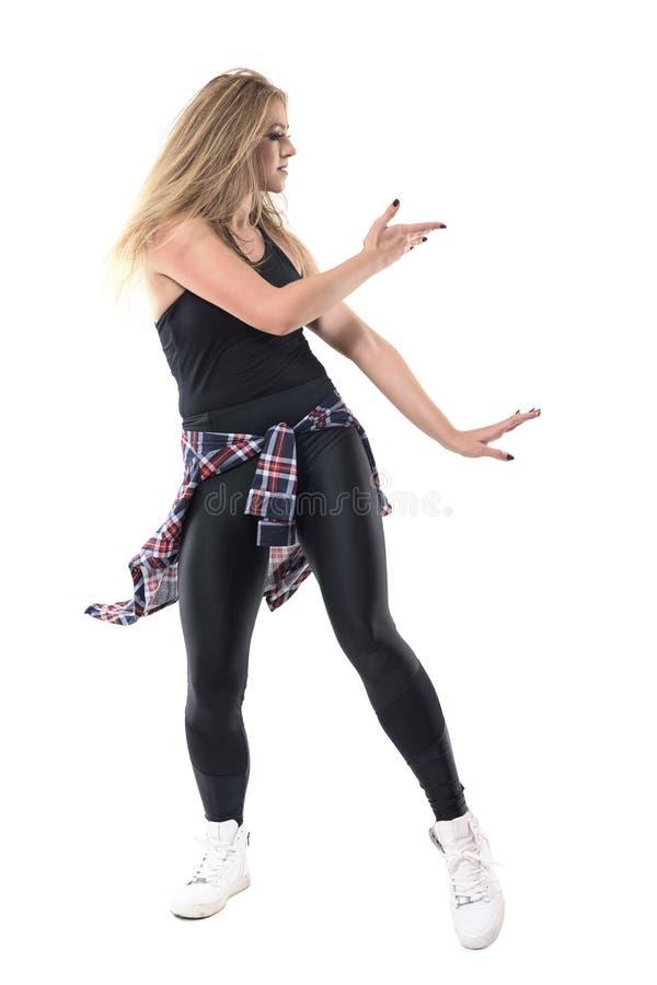 Opinión del perfil de los aeróbicos femeninos modernos de la danza del jazz del baile del movimiento del funcionamiento del baila imagen de archivo