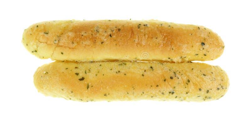 Opinión superior de las barras de pan de ajo sobre blanco fotografía de archivo
