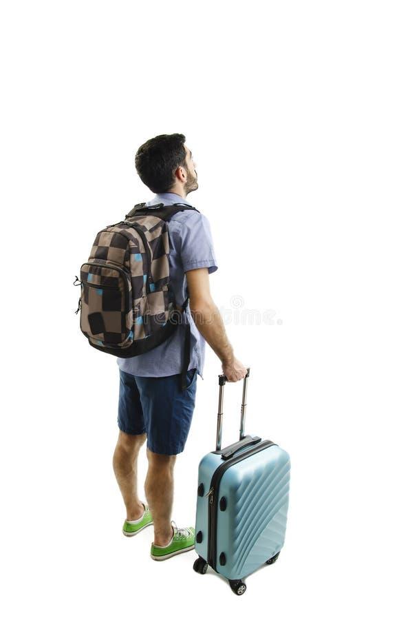 Opinión trasera el hombre con la mochila y la maleta que miran para arriba Colección de la gente de la vista posterior opinión de fotos de archivo