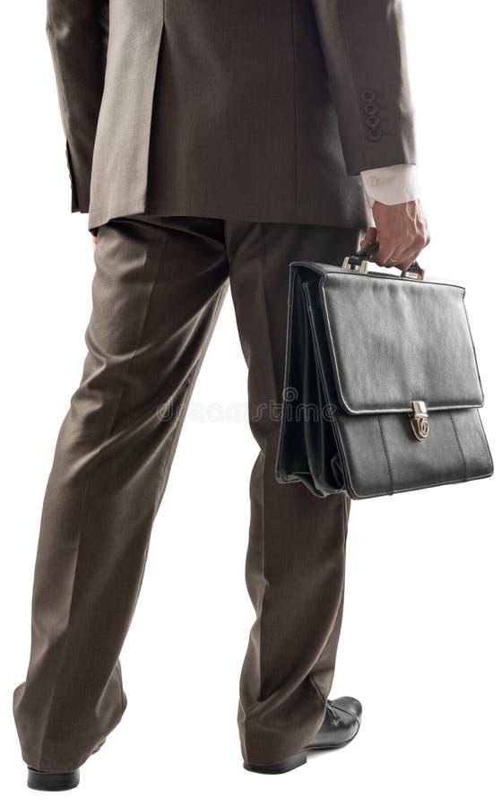 Opinión trasera el hombre de negocios con la maleta a disposición fotos de archivo