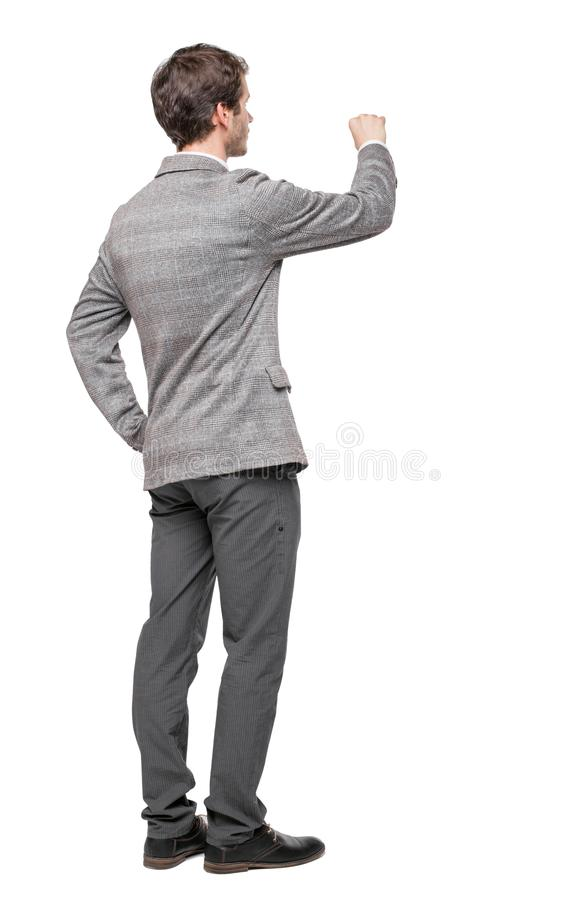 Opinión trasera el hombre de negocios de la escritura en traje foto de archivo