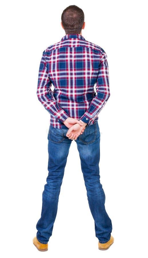 Opinión trasera el hombre hermoso en la camisa a cuadros que mira para arriba fotos de archivo libres de regalías
