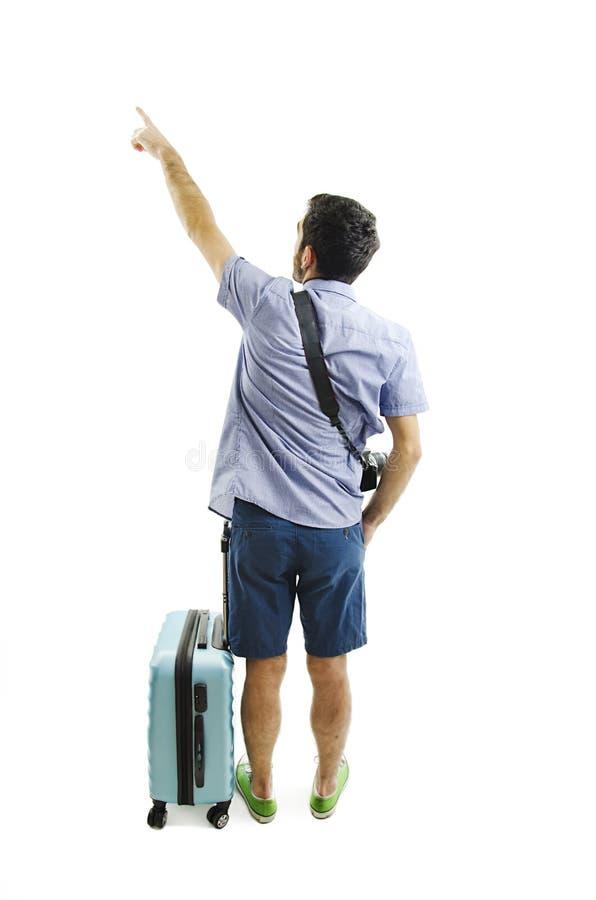 Opinión trasera el hombre punteagudo con la maleta opinión de la parte trasera la persona individuo con un bolso del viaje en las foto de archivo libre de regalías