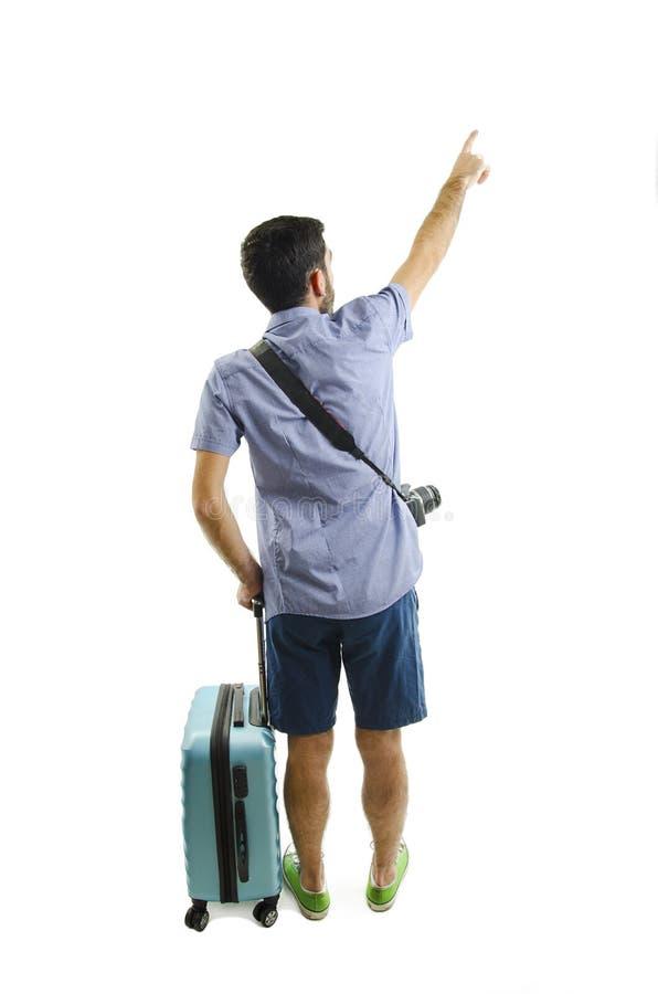 Opinión trasera el hombre punteagudo con la maleta opinión de la parte trasera la persona individuo con un bolso del viaje en las fotografía de archivo libre de regalías