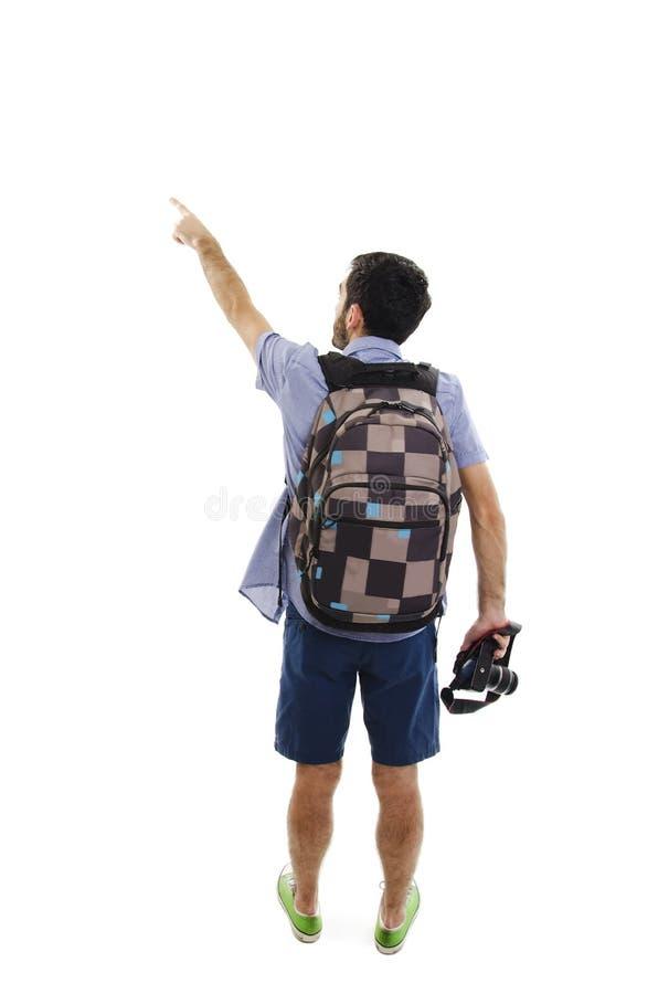 Opinión trasera el hombre punteagudo con la maleta opinión de la parte trasera la persona individuo con un bolso del viaje en las imagen de archivo