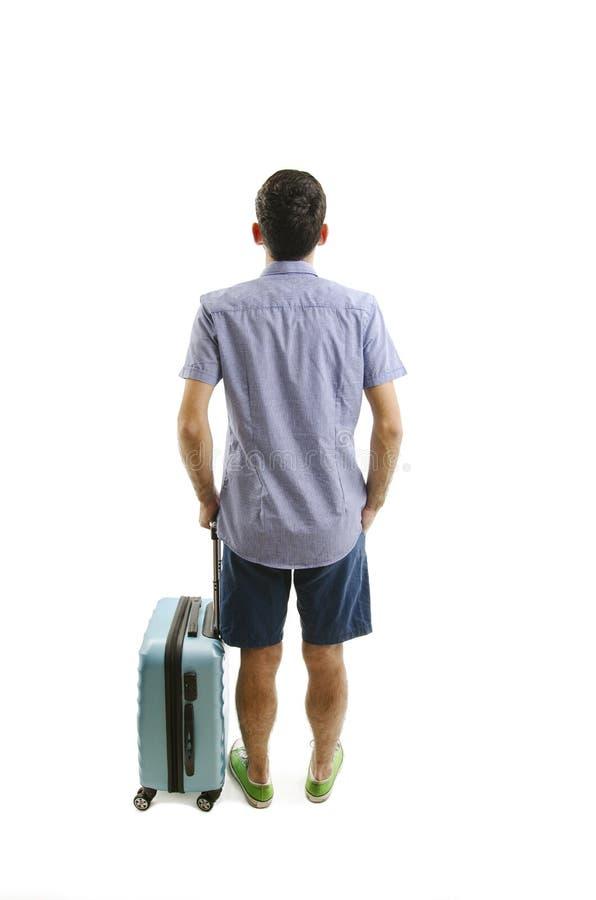 Opinión trasera el hombre que viaja con la maleta que mira para arriba Colección de la gente de la vista posterior opinión de la  imagen de archivo