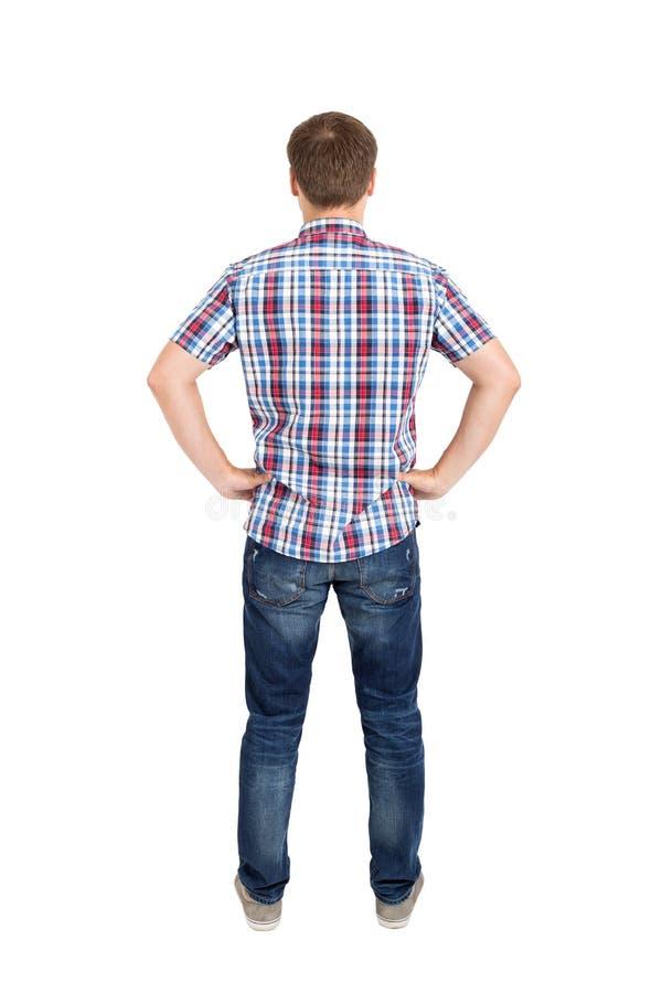 Opinión trasera hombres jovenes en camisa y vaqueros imagen de archivo