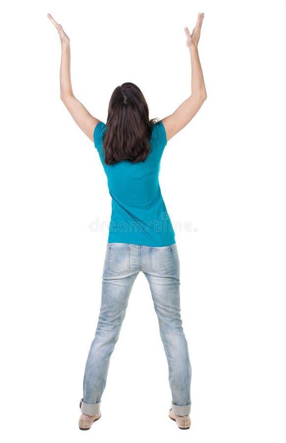 Opinión trasera la mujer alegre que celebra las manos de la victoria para arriba imágenes de archivo libres de regalías