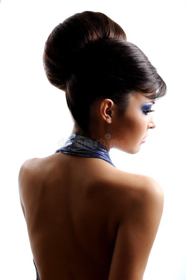 Opinión trasera la mujer con el peinado de la manera imagen de archivo libre de regalías