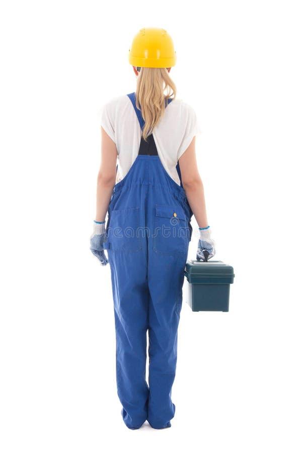 Opinión trasera la mujer en uniforme azul del constructor con la caja de herramientas aislada fotografía de archivo libre de regalías