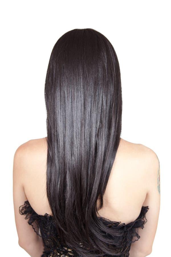 Opinión trasera la mujer joven con el pelo sedoso negro imágenes de archivo libres de regalías