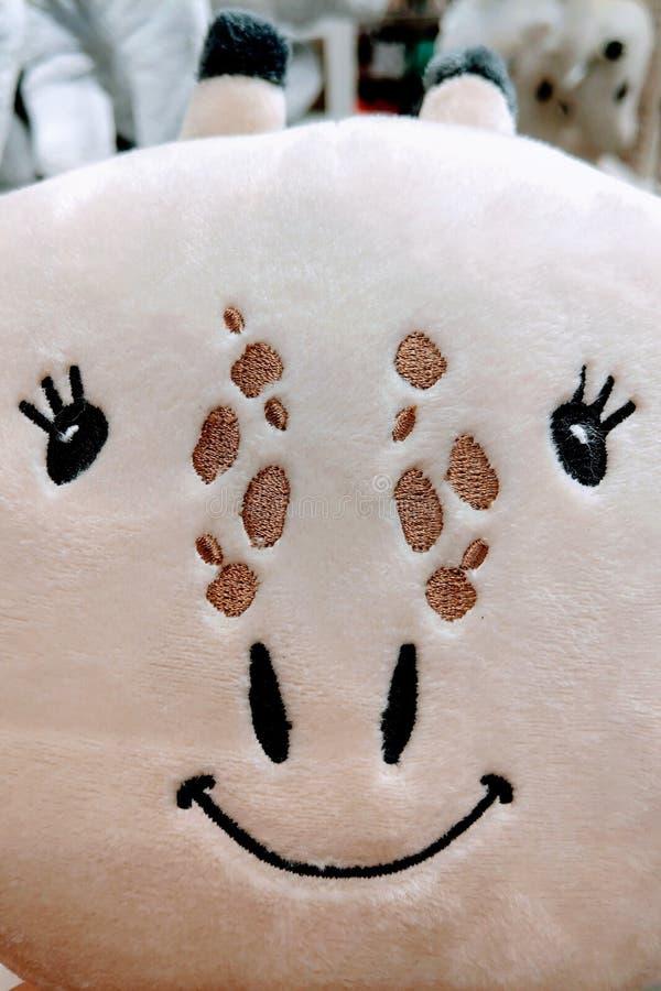 Opinión una jirafa de risa divertida, juguetes para los niños fotos de archivo libres de regalías