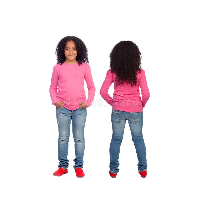 Opiniões dianteiras e traseiras uma menina afro-americano bonita fotografia de stock