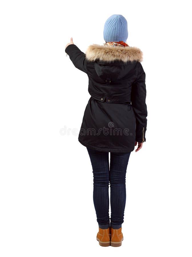Opini?o traseira a mulher nos polegares do Parka acima imagens de stock royalty free
