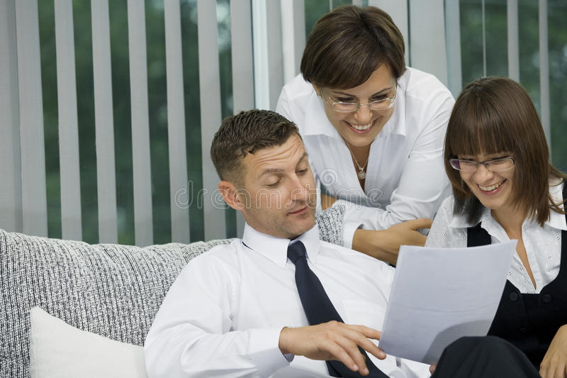 Opinion. Portrait of young business people discussing project in office environment stock image